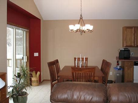 red accent wall what color will go with a rich brown accent wall and taupe