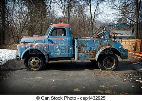 me a picture of a truck stock images of vintage tow truck in a parking lot