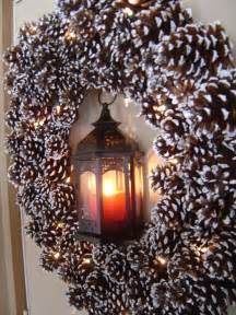 Pinecones to a grapevine base and paint it with white to imitate snow