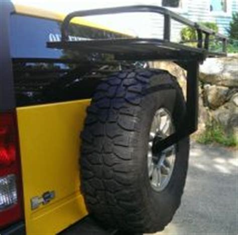 spare tire rack carry extra gear  cargo   spare tire rack leaves  room