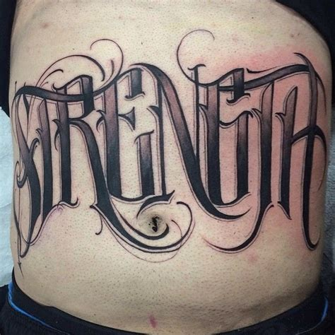 tattoo lettering vancouver strength script by elvia guadian black and grey