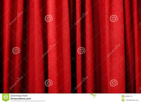 bright red curtains bright red curtain as a background or texture stock photo