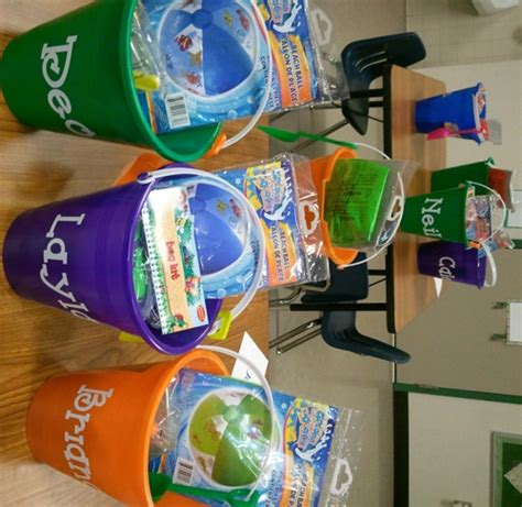 teacher presents to grade 1 students a summer survival kit for future 1st graders scholastic