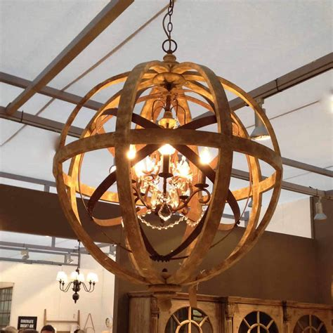 wooden orb chandelier metal orb detail and crystal by cowshed interiors notonthehighstreet.com