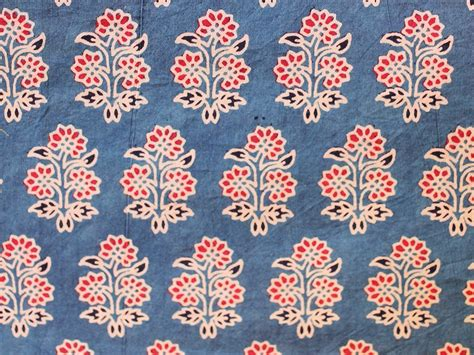 indigo blue hand block printed fabric with red floral motifs