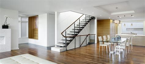 staircase design with dinning table dining room with staircase dining room modern with great room glass dining table wood flooring