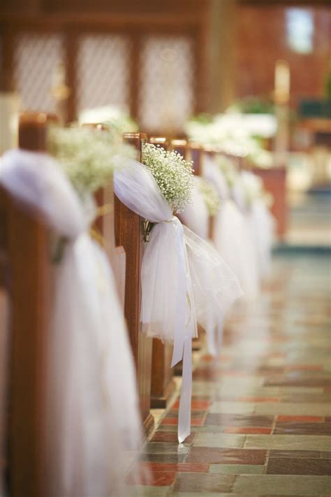 church wedding ceremony ideas 2 pew bows with tulle and baby s breath flowers by whimsical creations all white wedding