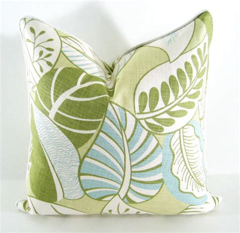 blue green decorative pillow cover in tropical leaves by