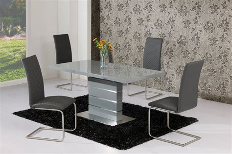 extending grey high gloss dining table   grey chairs