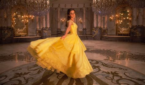 emma watson yellow dress beauty and the beast first look at belle and beast in disney s live action