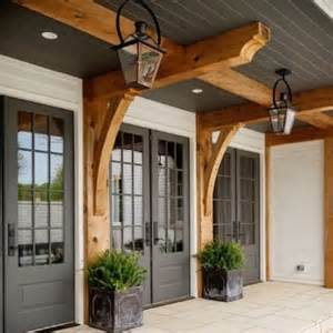 Beam X Front Of House farmhouse front porch with gray doors and wooden beams