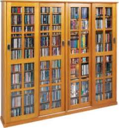 large dvd cabinet with doors how to organize your bluray dvd storage cabinet