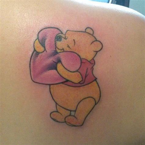 cute butt tattoos cuddly and courageous the friendly pooh hugs a