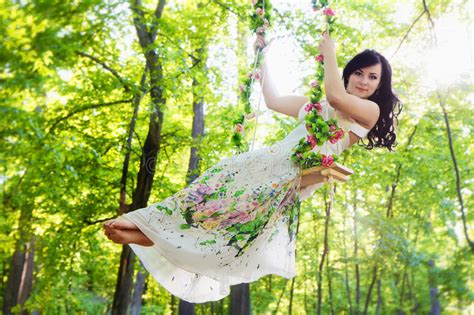 women and swinging young woman swinging in summer park stock image image of
