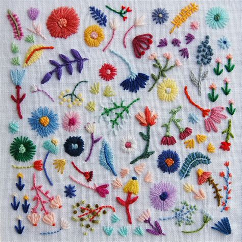 embroidery design making rainbow flowers large square on white linen hand