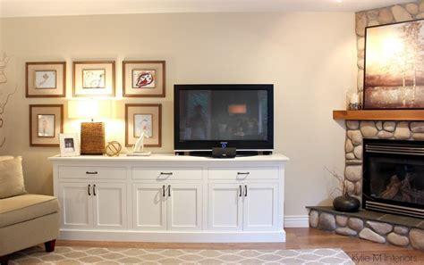 Benjamin Moore Gentle Cream. Corner fireplace in a living