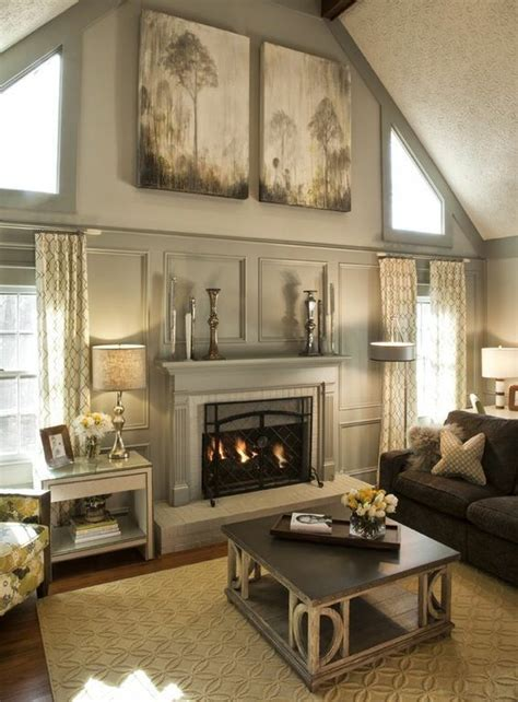 living room with wood paneling painted paneling and fireplace great rooms
