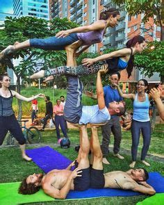 person images acro partner yoga yoga poses