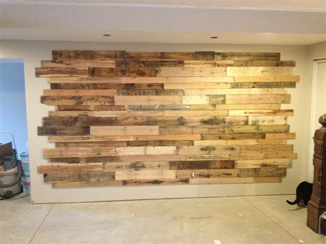 DIY wood accent wall with chalkboard and built in shelves