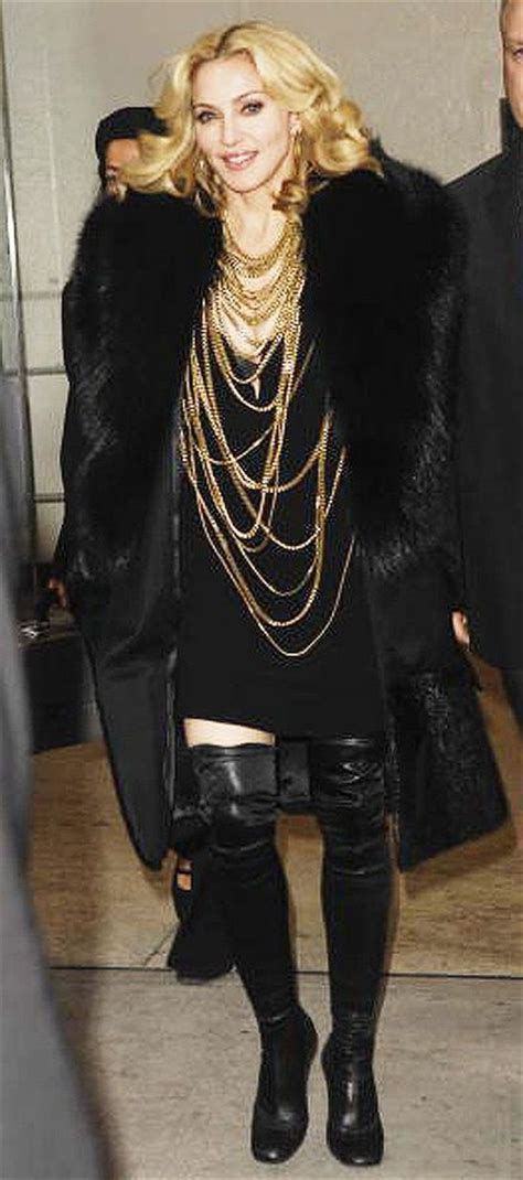 madonna in a fur coat madonna s style black fur coat lots of necklaces boots