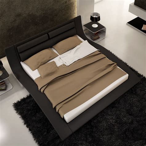 Modern bedroom design with black low profile king bed frame with leather headboard and white
