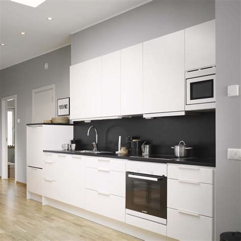 decordots modern white kitchen with black wall