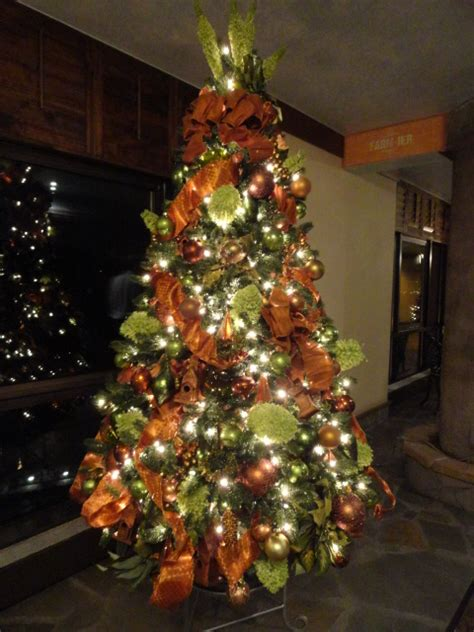 orange coloured christmas decorations interior design livened up with themed trees mjn and associates interiors