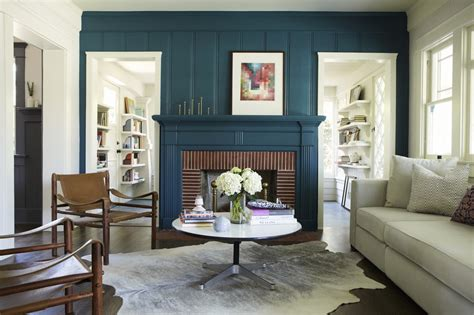how much to paint living room blue rustic fireplace