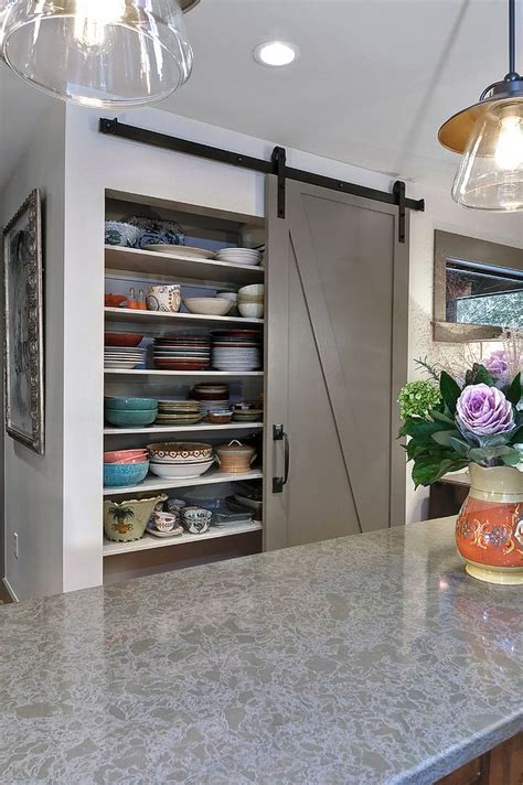 barn door pantry offers plenty of storage space for