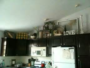 Some ideas for decorating above kitchen cabinets home decor