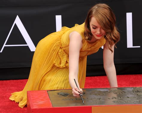 emma stone yellow emma stone proves mustard yellow is officially her color