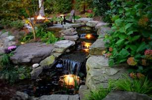 Alexandria sloped yard raised patio fire pit amp water feature