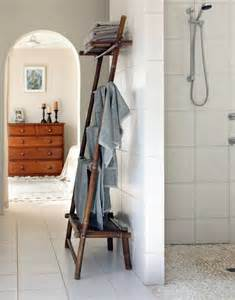 wooden towel ladder in both rustic as well as in modern