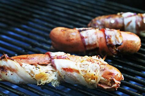 bacon wrapped dogs grill grilled bacon wrapped stuffed dogs recipe simplyrecipes