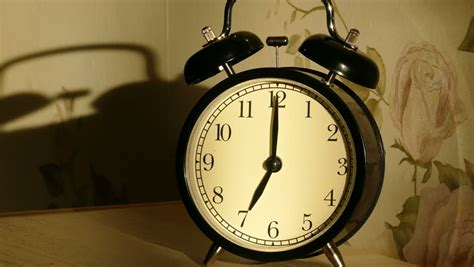 Nightstand Alarm Clock vintage alarm clock on nightstand counts the time and then loudly ringing stock footage