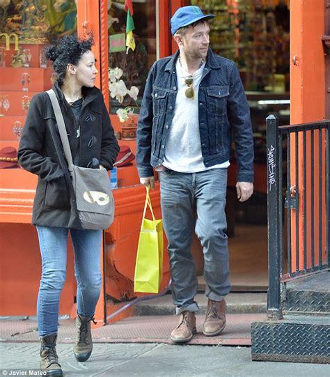 damon albarn enjoys shopping trip in new york with long