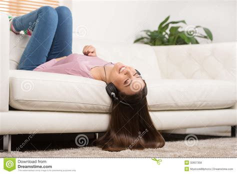 lay down on the couch listening to the music royalty free stock photos image