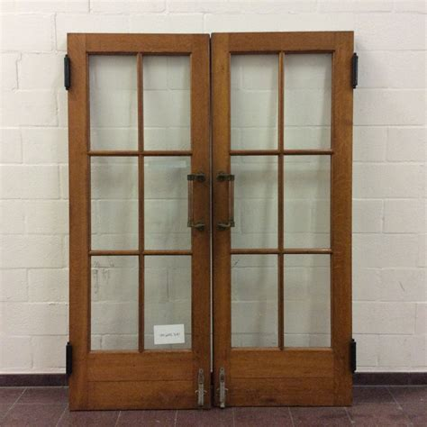 double swinging doors double swing door with brass door handles ca 1950s