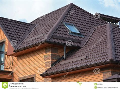 roofing construction with attic skylights gutter