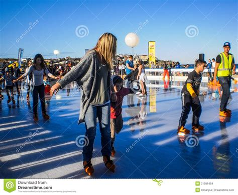 people having fun with ice skating editorial stock image