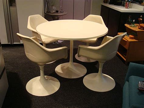 mixing modern chairs with antique table tulip chairs go vintage tulip table and chairs mid century modern from