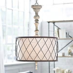 mixing modern chandelier with a traditional gesso spindle chandelier regina andrew