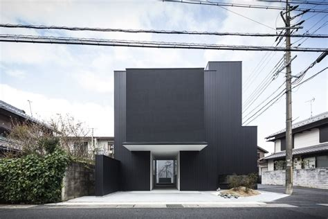 untamed geometry showcased by modern house exterior in distinct black white exterior showcased by minimalist