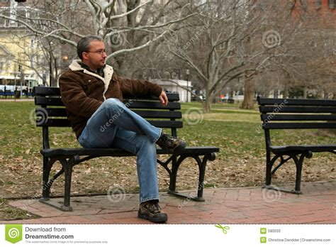 man bench young woman sitting on a bench in park stock image hot