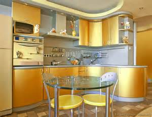 a modern gold kitchen with curved cabinets