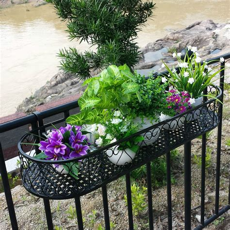 flower pots balcony railings photo balcony ideas wrought iron railing fence flower pots hanging oval frame