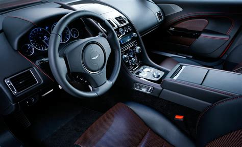 aston martin sedan interior car and driver
