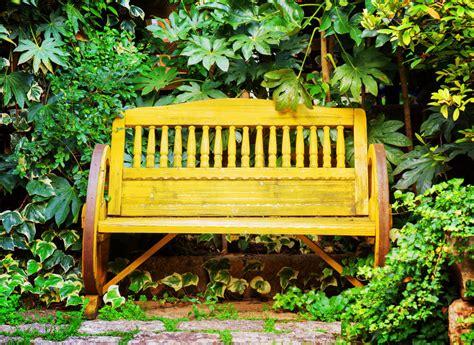 wagon wheel garden bench 60 garden bench ideas