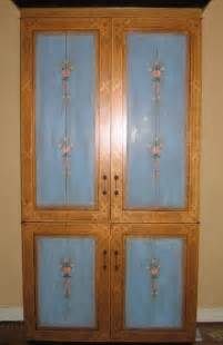 a copy of an italian painted armoire painted by