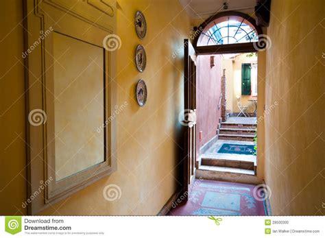 Bedroom Door Opens Into Hallway Interior View From Hallway Through Open Door To Courtyard